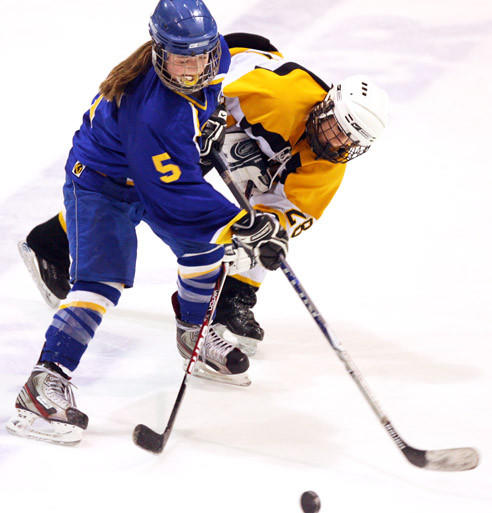 Hailey Gould (5) of the Aberdeen Cougars battles a Watertown player for the puck in a game from last year's state tournament.