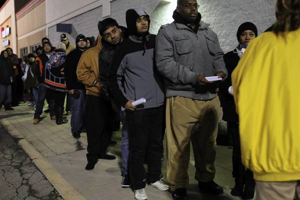 Shoppers wait in line at Best Buy in Aurora, Ill., for a midnight opening to kick off Black Friday.