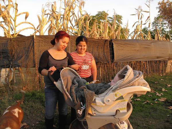 Jessica Sanchez, left, and her sister Marabel, who is blind, live in East Orosi, Calif., where water quality is so poor that they drink bottled water. In the stroller is Jessica's son Jordan.