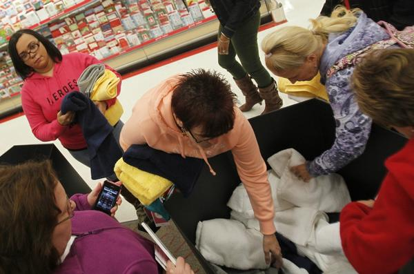 Shoppers peruse merchandise following the nine o'clock opening of Target in Newport News for Its Black Friday shopping event.