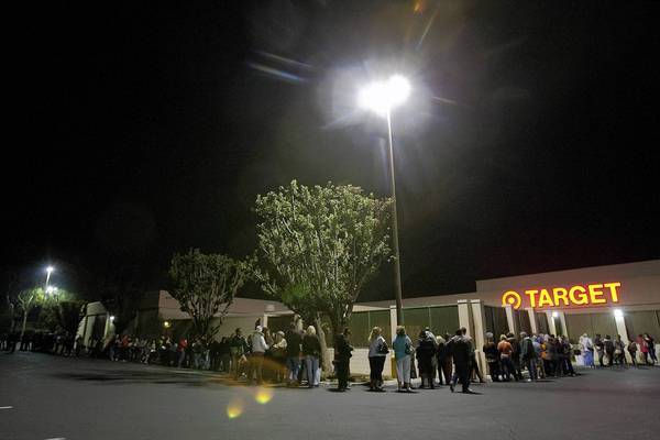 Hundreds of shoppers wait in a line that wraps around the back side of a Riverside Target store for a 9 p.m. opening on Thanksgiving.