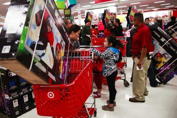 Black Friday shoppers flood through the doors at a Target in Burbank looking for deals and sales.
