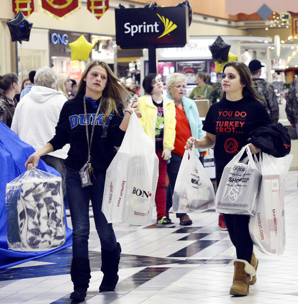 Amber Rager, left, and Jaden Barnes already have their hands full of their Black Friday shopping finds by 12:30 a.m. Friday at Valley Mall.