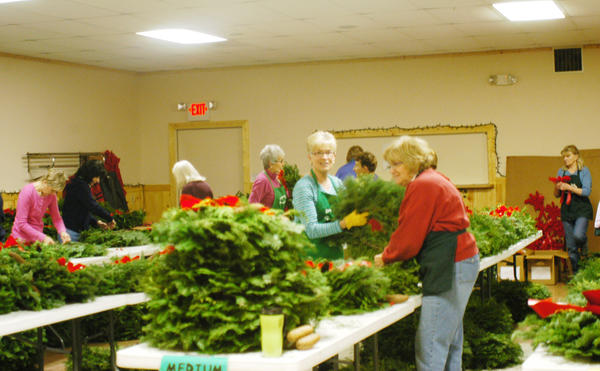 The Boyne City Eagles Hall filled with the scent of evergreen boughs Monday as Boyne Valley Garden Club members gathered for their annual wreath sale. Proceeds from the sale are used to purchase flowers for 15 individual Boyne City garden locations.