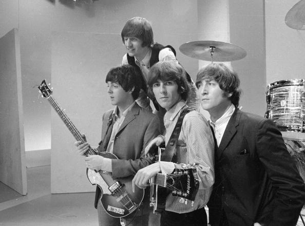 Members of the British popular rock and roll band The Beatles, (left to right) Paul McCartney, Ringo Starr, George Harrison (1943 - 2001), and John Lennon (1940 - 1980), pose for a group portrait during a rehearsal for a taping of a segment to be aired September 12 on The Ed Sullivan Show, New York, August 14, 1965.