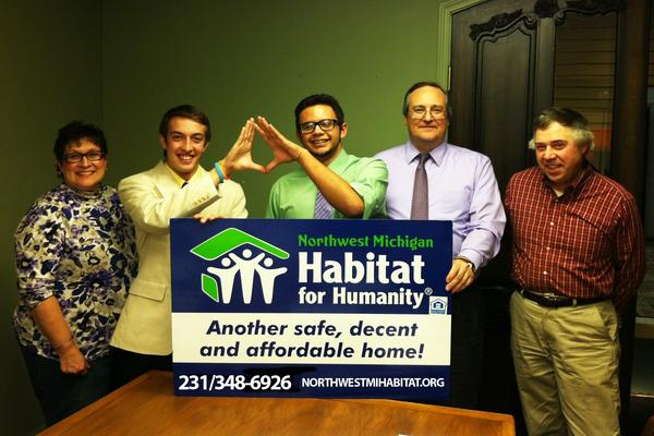 Preparing the DECA project for the newest Habitat build are (from left) Lani Laporte, Northwest Michigan Habitat for Humanity executive director; Quinn Harris and Nate McGann, Petoskey DECA student competitors; Kyle Kurtz, president, Habitat for Humanity; and Bill McMaster, Habitat board member.