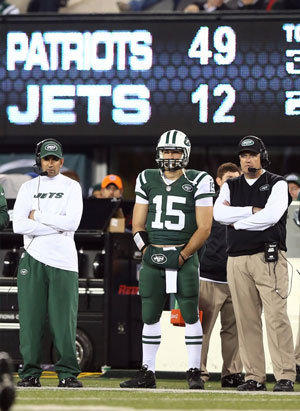 Tim Tebow stands next to New York Jets Coach Rex Ryan late in the fourth quarter of their game against the New England Patriots.