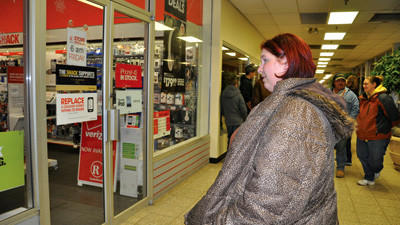 Amanda Enos, of Somerset, waits with a small crowd just before 6 a.m. to enter Radio Shack in Somerset on Black Friday for some shopping.