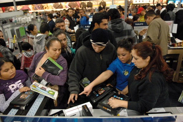 Shoppers shop for electronic tablets and laptops just after midnight on Black Friday at Best Buy in El Centro. Some shoppers had begun camping out in front of the store as early as Tuesday evening.