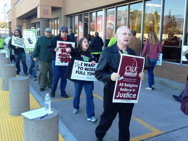 Protesters in front of the entrance to a Duarte Wal-Mart on Friday morning.