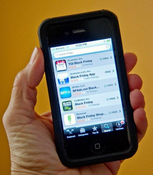 A photo illustration of the Apple App Store on the iPhone 4S.