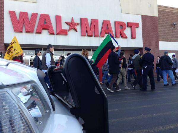 Police were present as the protest took place at the Flatbush Avenue Walmart in Hartford Friday morning.