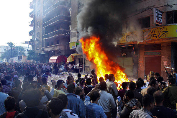 Protesters storm an office of Egyptian President Mohamed Morsi's Muslim Brotherhood Freedom and Justice party and set fires in the Mediterranean port city of Alexandria on Friday.