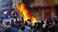 CAIRO -- Clashes between supporters and opponents of President Mohamed Morsi erupted across Egypt on Friday following the president's decree to expand his power in a nation increasingly polarized by its troubled transition to democracy after last year's revolution.