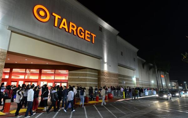 Target, Toys R Us, Sears and other retailers said the earlier Black Friday hours paid off in longer lines of shoppers.
