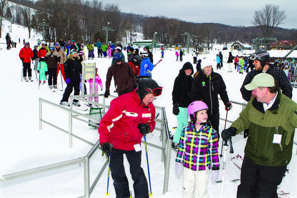 A group of skiers gets ready to ride the chairlift at Boyne Highlands in Harbor Springs during the 2011-12 ski season.