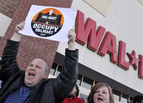 Protestors rally outside the Flatbush Avenue Walmart in Hartford Friday.