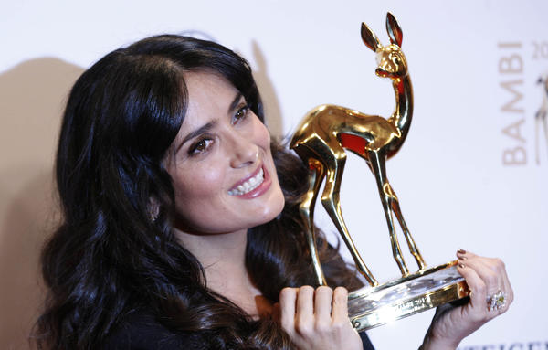 Mexican actress Salma Hayek poses with her trophy for Film International during Bambi 2012 media awards ceremony in Duesseldorf. The annual Bambi awards honours celebrities from the world of entertainment, literature, sports and politics.