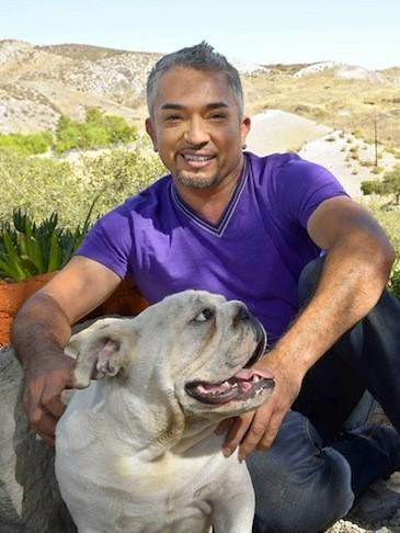 Cesar Millan with his English bulldog George at Millan's Dog Psychology Center in Santa Clarita.