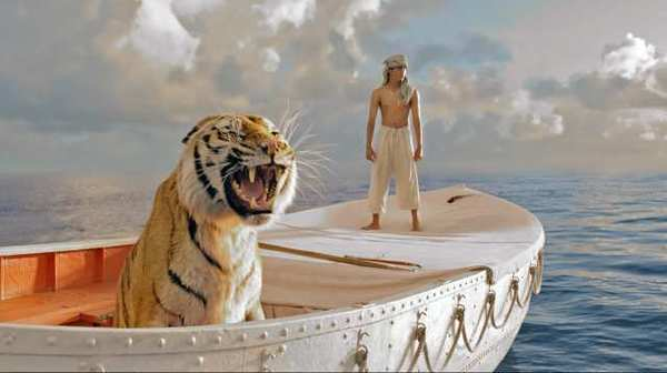 """Pi Patel"" (Suraj Sharma) and a fierce Bengal tiger named ""Richard Parker"" must rely on each other to survive an epic journey in ""Life of Pi."""