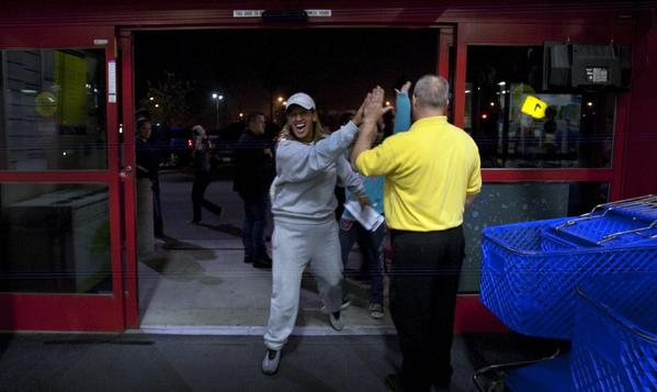 Alicia Romero celebrates Black Friday deals at the Best Buy in Lakewood, Calif.