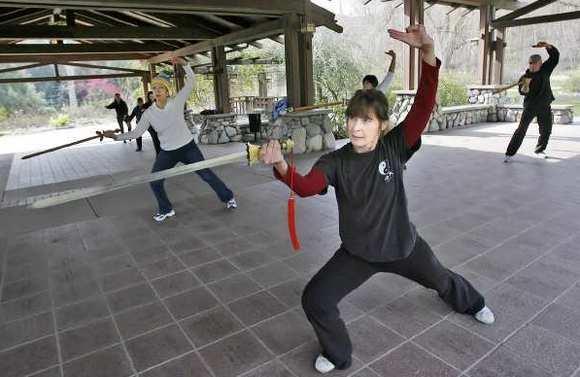 Tai Chi instructor Laura Gloster of Monrovia leads one of two one-hour classes at Descanso Gardens in La Cañada Flintridge on Tuesday, February 2.