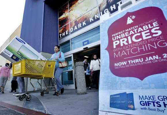 Customers steadily came out with large items like television sets from the Empire Center's Best Buy in Burbank on Friday, Nov. 23, 2012.