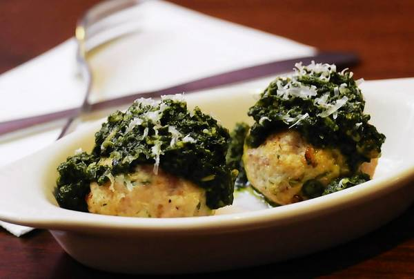 Chicken meatballs with pesto sauce.