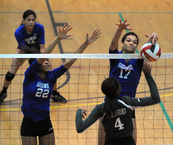 Sherwood (in blue) won three volley ball matches against Arundel in the state finals at the University of Maryland Ritchie Coliseum. Sherwood #22 is Kerra Tirado. Sherwood #17 is Alex Holston. Arundel #4 is Ashlee Felton.