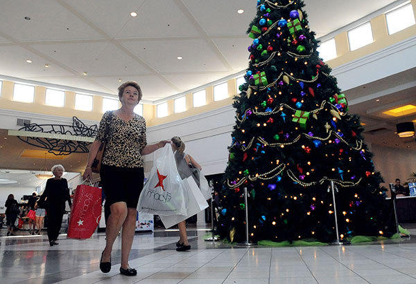 Diane Gersonof Key West shops at the Town Center mall Friday, the first day of the holiday shopping season.