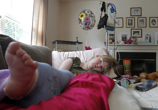 Fourteen-year-old Haylee Short rests on the couch at home in Hampton on Friday. After arriving on a bus to Phoebus High School on September 24, doctors discovered that Short sustained a broken femur. Her mother, Renea Havard, says the injury took place on the bus and Short's wheelchair was also damaged.