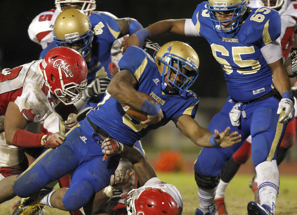 Hampton's Marshawn Williams stretches around the Phoebus defense to score a touchdown during the first quarter of Thursday's game.