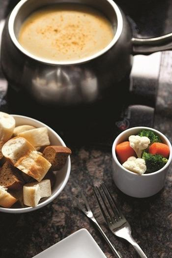 Serve cheese fondue to holiday guests