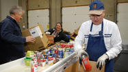Food banks see increase in needy clients, feel pinch in food costs