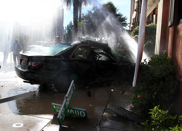 A Toyota Camry severed a water line in front of Olive's Bistro in Burbank on Friday, Nov. 23, 2012.