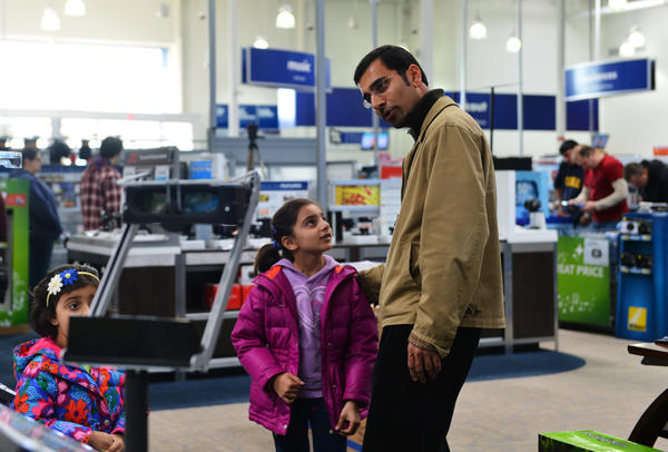 Asad Chaudry, Inaaya Chaudry, 6 (center) and Ayaana Chaudry, 3 looks at the 3D flat screen tv prices, with his daughters at Best Buy in Easton on Black Friday. admits that he is more of an online shopper and will probably wait till Cyber Monday if he does buy.