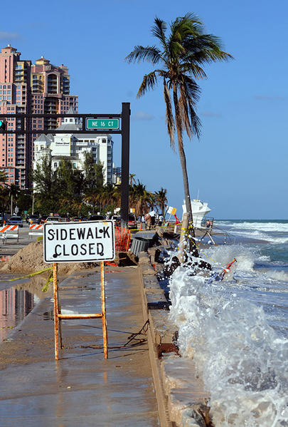 High tide broke\ through a small portion of the wave wall and sidewalk on North Beach (A1A at NE 16 Court). FLPD is in the process of reducing traffic to two lanes. Motorists are advised to avoid the immediate vicinity according to Matt Little, PIO, City of Fort Lauderdale.The other three miles of Fort Lauderdale Beach are not affected.