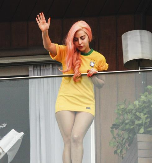 Lady Gaga waves to the fans at the hotel where she is staying in Rio de Janeiro