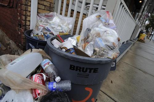 Trash sits uncollected in the 200 block of East 5th Street Wednesday.