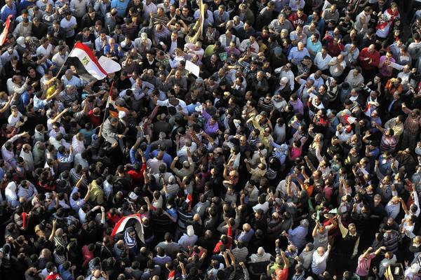 Protesters gather in Cairo's Tahrir Square to denounce President Mohamed Morsi's recent decree to expand his authority.