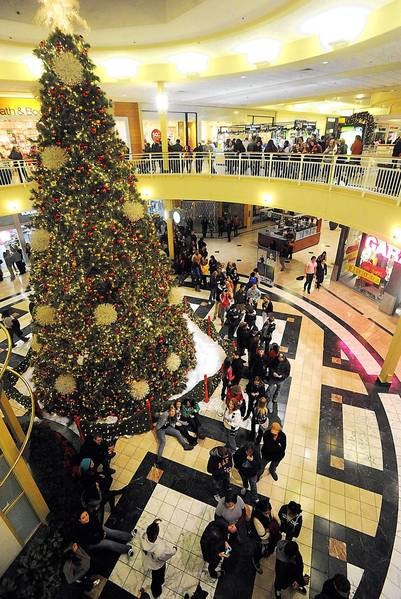 Shoppers wait late Thursday for shops to open at the Lehigh Valley Mall at midnight. The mall was among several retailers to kick off Black Friday shopping hours earlier than usual.