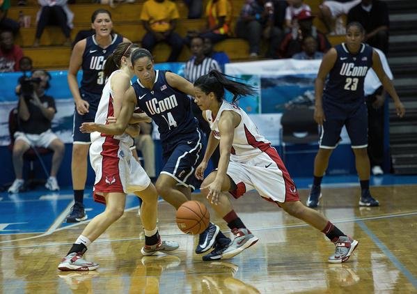 UConn's Bria Hartley keeps Marist's Natalie Gomez outside the lane at the Paradise Jam Friday.