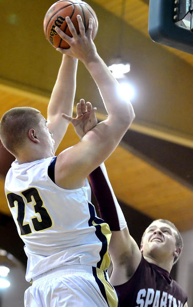St. Maria Goretti's Martin Geben (23) scores over Bishop Walsh's Brandon Reed during Friday night's game in the mid-Atlantic Invitational Tournament.