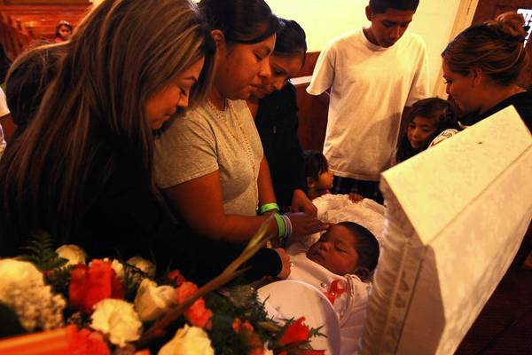 Ivonne Rangel, 31, second from left, mourns for her 2-year-old son Daniel, who died of leukemia, during his funeral in Kettleman City. Many residents of the community believe a nearby toxic waste dump is to blame for serious illnesses, birth defects and deaths among children.