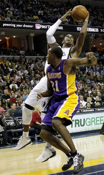 Memphis guard Mike Conley shoots over Chris Duhon.