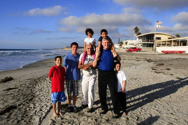 Newly elected San Diego County Supervisor Dave Roberts, right, and his spouse, Wally Oliver, center, with their five children, from left: Alex Oliver, 12, Robert Roberts, 17, Natalee Roberts, 4, Joe Roberts, 5, and Julian Oliver, 8, at Del Mar City Beach.