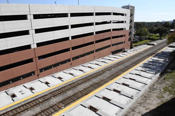 Concrete foundations are constructed alongside the railroad tracks that traverse through Florida Hospital's Orlando campus in preparation for SunRail traffic.