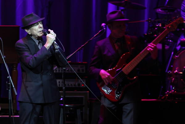 Leonard Cohen, left, performs during a concert at the Akoo Theatre Friday in Rosemont.