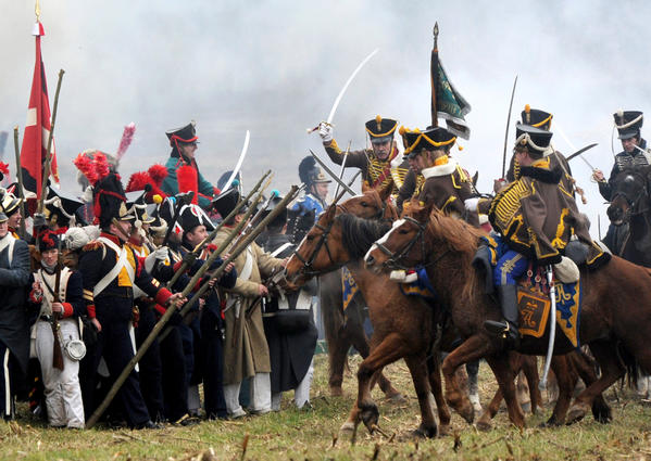 Military history enthusiasts dressed as 1812 Russian and French soldiers take part in a staged battle to mark the 200th anniversary of Napoleon's army retreat from Russia across the Berezina River near the village of Studenka, about 85 kilometres from the capital Minsk, on November 24, 2012. About 50,000 people, soldiers from both sides and civilians, were killed during the crossing. In total of nearly half a million soldiers, from France as well as all of the vassal states of Europe, who invaded Russia in June 1812, barely 10,000 survived by the end of the campaign in December 1812.