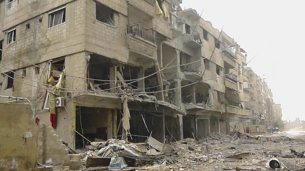 Buildings damaged after a Syrian Air Force fighter jet loyal to Syria's President Bashar al-Assad fired missiles at Daria are pictured near Damascus November 24, 2012.